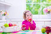 foto of healthy eating girl  - Child eating breakfast - JPG