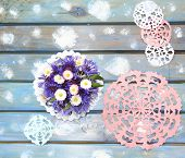 image of christmas flower  - Lovely paper snowflakes and a bouquet of flowers on a blue wooden table a Christmas background - JPG