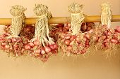 image of red shallot  - Shallot onions in a group on bamboo - JPG
