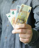 stock photo of holding money  - businessman hands holding european money  - JPG