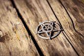 stock photo of wiccan  - Old steel Pentagram closeup photo on background - JPG