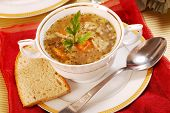 picture of tripe  - traditional polish tripe soup with vegetables in white elegance dishware - JPG