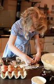 image of pastry chef  - Young girl who is cutting out pastry with pastry cutter - JPG