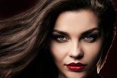 foto of  lips  - Beauty closeup portrait of attractive elegant brunette woman with red lips and long hair - JPG