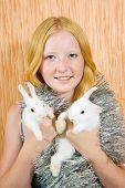 foto of tawdry  - teen girl with two white pet rabbits - JPG