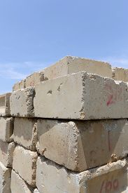 picture of cornerstone  - Stack of concrete blocks against a blue sky - JPG
