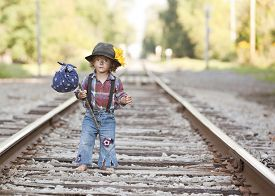 foto of hobo  - Adorable toddler on the railroad tracks dressed as a little hobo - JPG