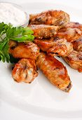 stock photo of chicken wings  - Chicken wings with sauce - JPG