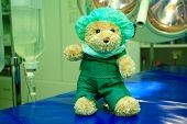 stock photo of endoscopy  - Green teddy bear in the operation room - JPG