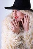 Curly Blonde In A Black Hat And White Fluffy Fur Coat poster