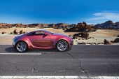 Sports car on the road. Non-branded concept car. poster