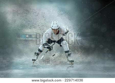 poster of Caucassian ice hockey Player in dynamic action in a professional sport game play around splash drops