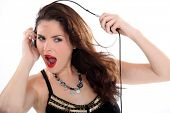 Crazy woman stretching her headphones
