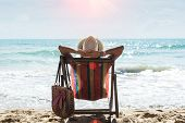 Happy Woman Sitting On A Deck Chair At The Beach,relax On The Tropical Beach. Travel Concept poster