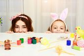 Easter Holiday, Easter Day, Happy Family, Holiday Concept, Mother And Daughters Painting Easter Eggs poster