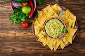 Guacamole Avocado, Lime, Tomato, Onion And Cilantro, Served With Nachos - Traditional Mexican Snack. poster
