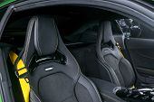 Modern Luxury Sport Car Inside. Interior Of Prestige Car. Black Leather Seats With Yellow Stitching. poster