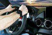 Male Hands Holding Car Steering Wheel. Hands On Steering Wheel Of A Car Driving Near The Lake. Man D poster