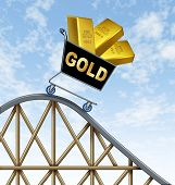 stock photo of errat  - Economic rollercoaster ride representing the falling value of gold due to international economy stress represented by a shopping cart fall with golden yellow metal bars in it - JPG