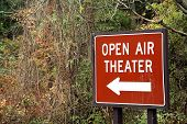 stock photo of matinee  - Sign leading to an old open air theater that is only open during the summer for plays - JPG
