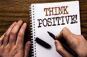 Handwritten Text Showing Word Think Positive. Business Concept For Positivity Attitude Written Table poster