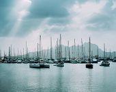 Sailboats And Pleasure Boats In The Porto Grande Bay Of The Historic City Mindelo. Clodscape With Su poster