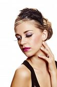 Beautiful blond woman with fashion make-up wearing hair in a classic french roll updo hairstyle with