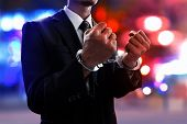Businessman In Handcuffs On The Streets At Night poster