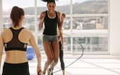 Women Enjoying Jumping Rope Workout At Gym poster