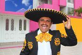Charro mariachi man portrait shouting in mexican pink house