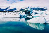 Amazing View Of Icebergs In Glacier Lagoon, Jokulsarlon, Iceland. Global Warming And Climate Change  poster