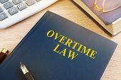 Overtime Law And Calculator In An Office. poster