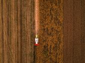 Corn Maize Harvest, Aerial View Of Combine Harvester Working On Ripe Maize Crop Field From Drone Pov poster