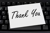 stock photo of thank-you  - Computer keyboard with a thank you card Thank you for your business - JPG