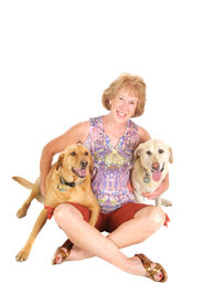 image of beautiful senior woman  - Attractive senior woman with her labrador retriever dogs on a white background - JPG