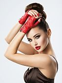 Beautiful sensual woman with glamour makeup. Pretty sensual young adult girl in red leather gloves poster