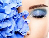 Makeup Face Flower Blue Woman Fashion. Closeup face of young beautiful woman with a blue makeup of e poster