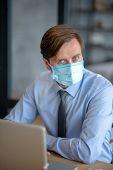 Responsible Businessman Wearing Mask While Having Flu poster