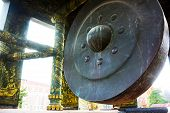 a Buddhist Giant Gong Huge Bronze Gong In A Buddhist Temple Sihanoukville Cambodia poster