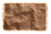 very detailed hi res photo of a burlap canvas isolated with lacerate edge, for backgrounds, textures
