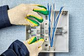 Technician Installs A Home Fusebox Or Electrical Consumer Unit Wiring Panel. Electrician Install Cir poster