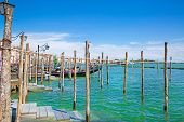 Gondolas And Turquoise Waters Of Canal In Venice, Veneto, Italy. Sunny Summer Day With Blues Sky. Gr poster