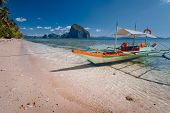 Tourist Banca Boat On Beach Ready For Island Hopping With Beautiful Scenery Of Surreal Pinagbuyutan  poster