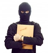picture of top-secret  - Bandit in black mask in handcuffs with top secret envelope isolated on white - JPG