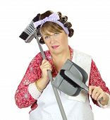 picture of forlorn  - Middle aged frumpy house looks forlorn and exasperated holding a dust pan and broom - JPG
