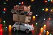 Toy Retro Car Fiat 500 Brought New Year Gift Boxes. Presents Tied With Jute Rope To Roof. The Mood O poster