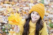 Carefree And Relaxed. Autumn Skin Care Routine. Kid Wear Warm Knitted Hat. Girl Relaxing Autumn Natu poster