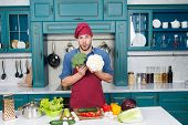 Man At Kitchen Concept. Fresh Veggies. Handsome Cook In Kitchen. Chef Following Recipe. Cooking Dinn poster