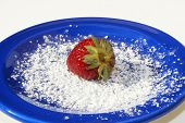 Single Strawberry On Blue Plate