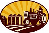 stock photo of silo  - Illustration of a farmer driving a vintage farm tractor with barn and silos in background done in retro woodcut style - JPG